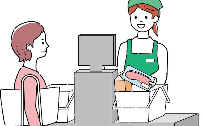 レジを使用する女性