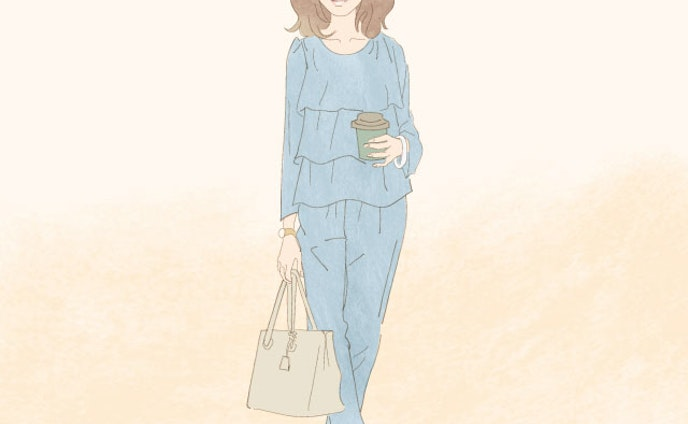 セットアップを着る40代女性
